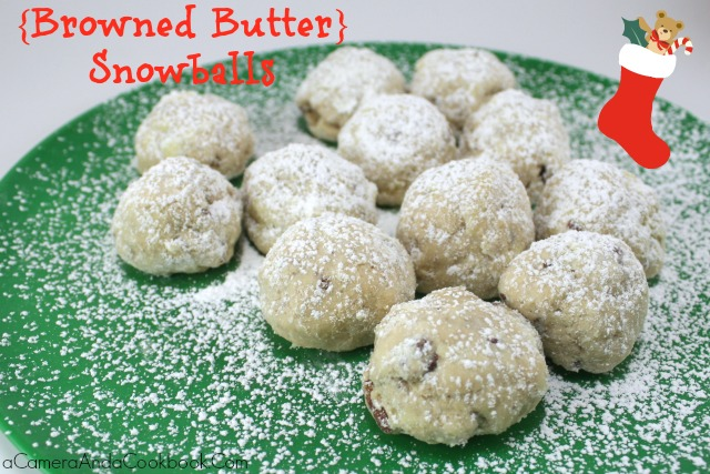 Lysha @ a Camera & a Cookbook shares 12 delightful Christmas treat recipes for this holiday season.  Today she is sharing Snowballs made with browned butter