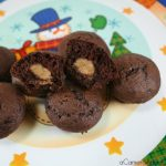 Peanut Butter Stuffed Chocolate Mini-Muffins are a great treat to bring to all those holiday parties.