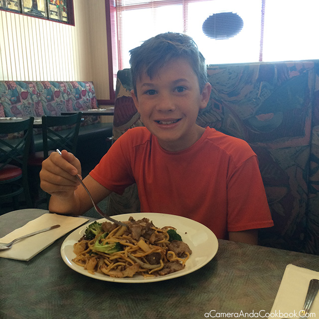 Alex enjoying Chang's Mongolian Grill